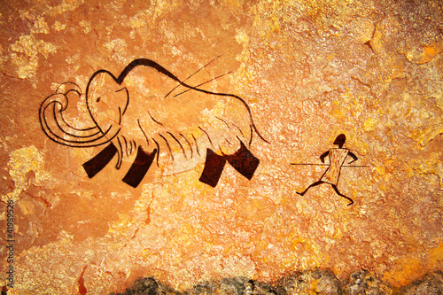 Cave painting of primitive hunt Poster