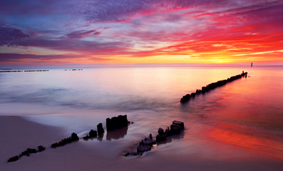 Fototapeta Baltic sea at beautiful sunrise in Poland beach.