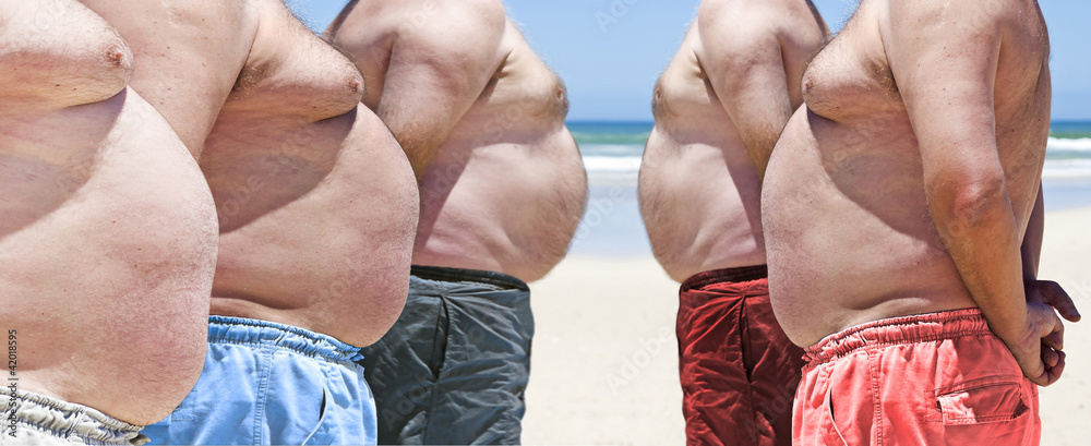 Fototapeta Five very obese fat men on the beach