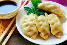 A Plate Of Fried Chinese Gyoza...