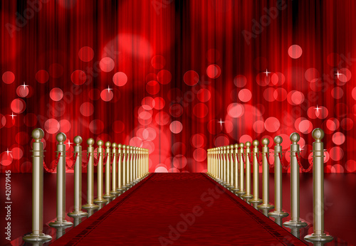 Photo  red carpet entrance with red Light Burst over curtain
