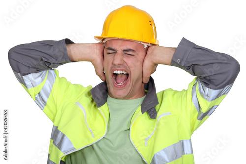 Plakaty BHP pracownicy-zakrywali-uszy