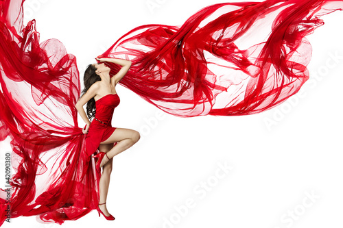 Foto-Doppelrollo - Beautiful woman dancing in red dress flying on a wind flow over (von inarik)