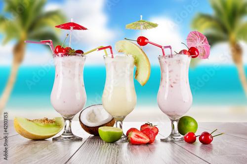Fototapeta Pina colada drinks with blur beach on background obraz na płótnie