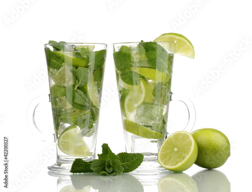 In de dag Buffet, Bar Glasses of cocktail with lime and mint isolated on white