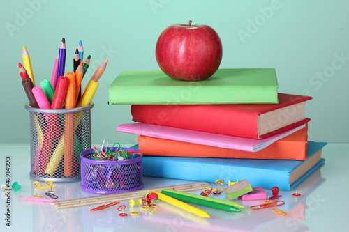 Fototapety, obrazy: Composition of books, stationery and an apple