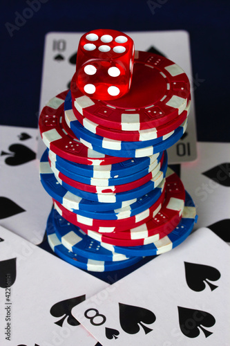 Recess Fitting Fairytale World poker cards, chips and dice close-up