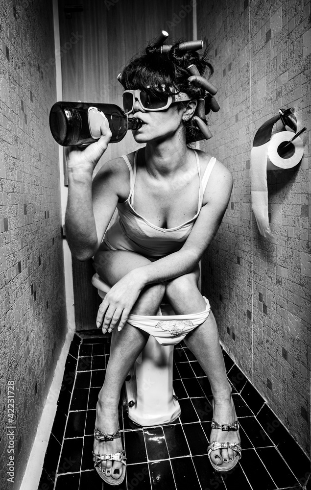 Fototapeta girl sits in a toilet