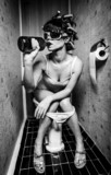 Fototapeta Teenage - girl sits in a toilet
