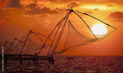 Montage in der Fensternische Ziegel Sunset over Chinese Fishing nets in Cochin