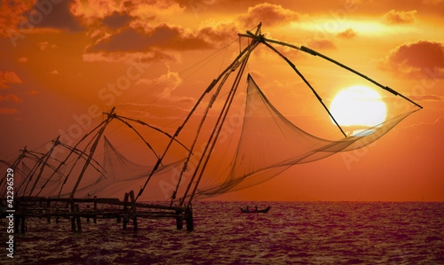 Foto auf Gartenposter Ziegel Sunset over Chinese Fishing nets in Cochin