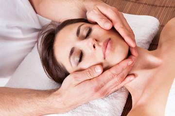 Fototapeta na wymiar Beautiful young woman getting face massage