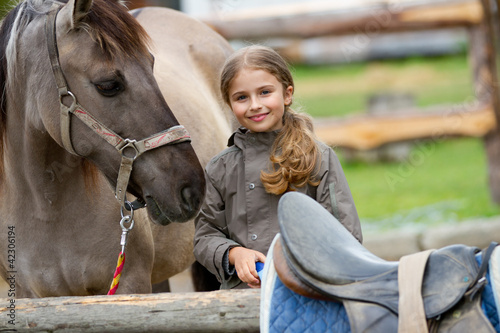 Poster Equitation Horse and lovely girl on a ranch