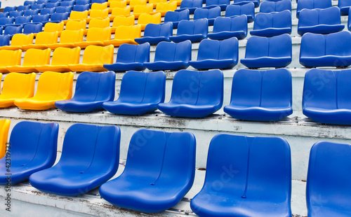 Papiers peints Stade de football Empty plastic seats in a stadium