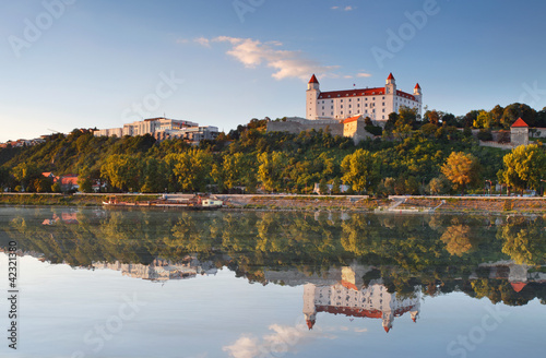 Photo  Bratislava castle with reflection in river Danube - Slovakia