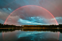 Full Rainbow Over The Lake