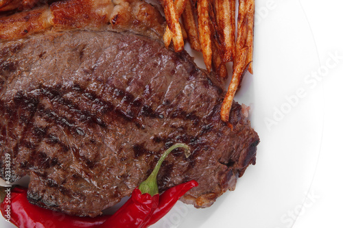 Fotobehang Steakhouse beef steak with potato chips and dry red hot chili peppers