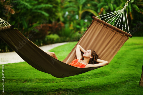 Fotografie, Obraz  Young beautiful woman in hammock, Bali, Indonesia