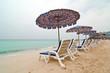 Beach chairs with umbrella on the white sand beach