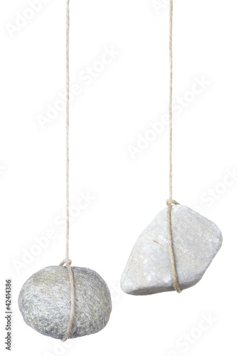 Fotomural  Stone hanging by a string isolated, clipping path included