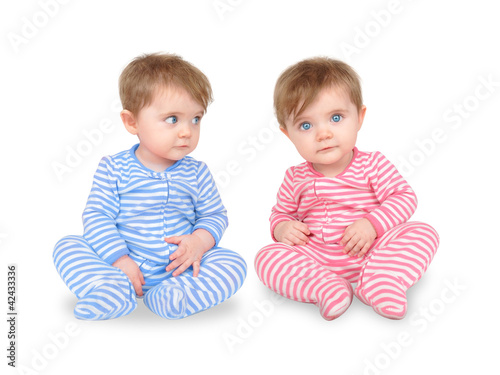Photo  Curious Twin Babies on White