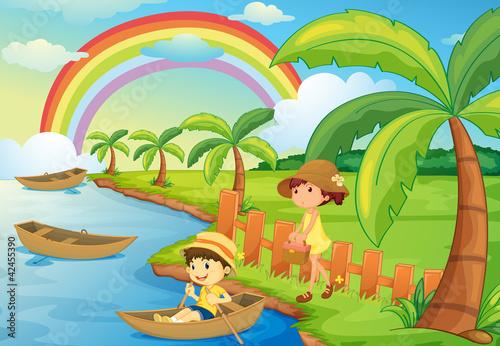 In de dag Regenboog a boy and girl are boating