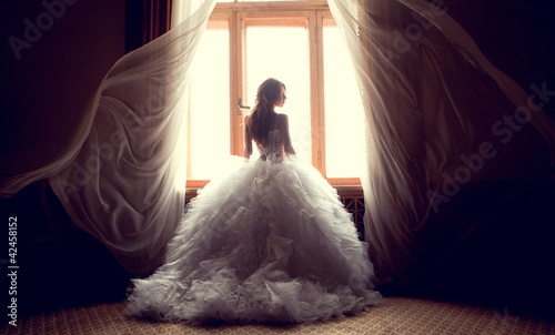 The beautiful bride against a window indoors Fotobehang