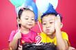Leinwandbild Motiv Asian kids celebrating birthday