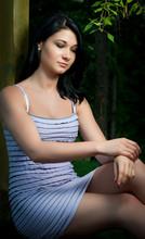 Beautiful Girl Sitting On Rail...