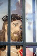 Jesus Christ Head Statue Behind Bars