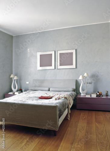 moderna camera da letto con parquet - Buy this stock photo and ...