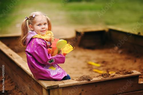 Fotografie, Obraz  Adorable little girl playing in a sandbox