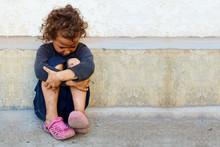 Poor, Sad Little Child Girl Si...