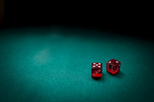 Two Red Dice On A Card Table