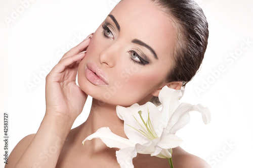 Obraz Portrait of a beautiful woman with a flower - fototapety do salonu