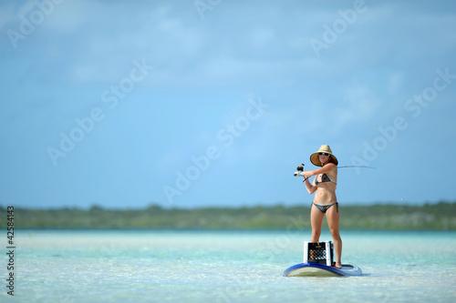 Printed kitchen splashbacks Fishing Fishing and paddleboarding in tropical destination