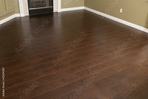 Newly Installed Brown Laminate Flooring and Baseboards in Home Canvas Print