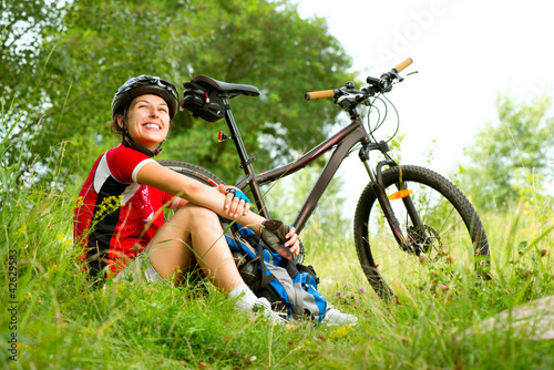 Fotografie, Obraz  Happy Young Woman riding bicycle outside. Healthy Lifestyle