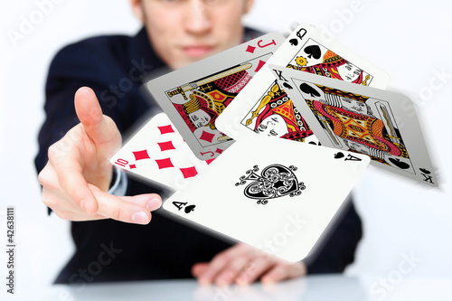 Young man showing poker cards плакат