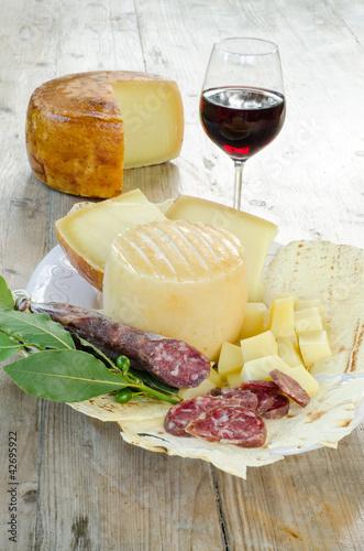 Photo  pecorino sardo cheese,carasau bread and sausage from Sardinia