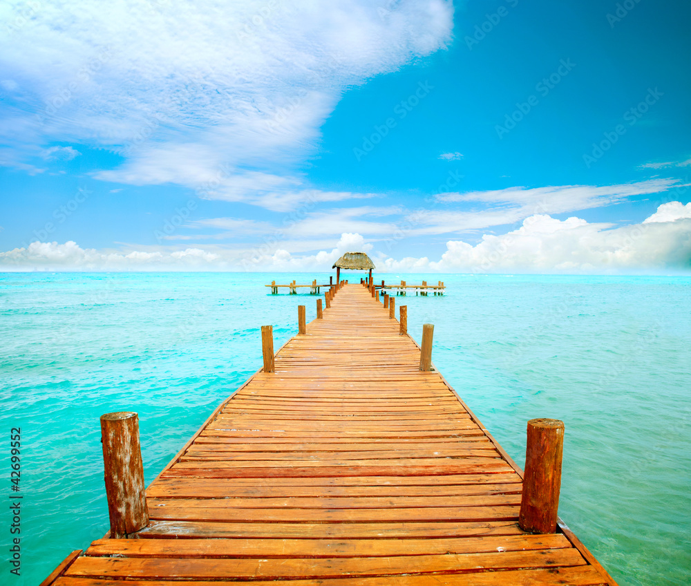 Fototapeta Vacations And Tourism Concept. Jetty on Isla Mujeres, Mexico