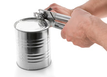 Opening Tin With Can Opener Is...