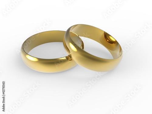 Photo Złote i srebrne obrączki ślubne wyizolowane na białym tle