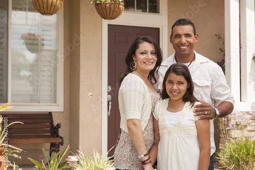 Fotografie, Obraz  Small Hispanic Family in Front of Their Home