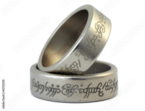 Fotografie, Tablou  Two rings of porous silvery metal with arabic ligature isolated