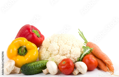 Poster Légumes frais Healthy seasonal raw vegetables on white background