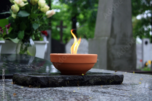 Foto op Canvas Begraafplaats candle burning on cemetery