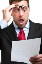 Shocked Businessman While Read...