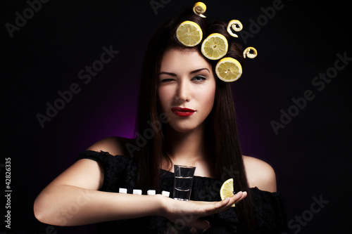 Fotografie, Obraz  Sexy woman with lemons in her hairstyle