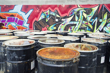 Rusty Oil Drums In Urban Setting